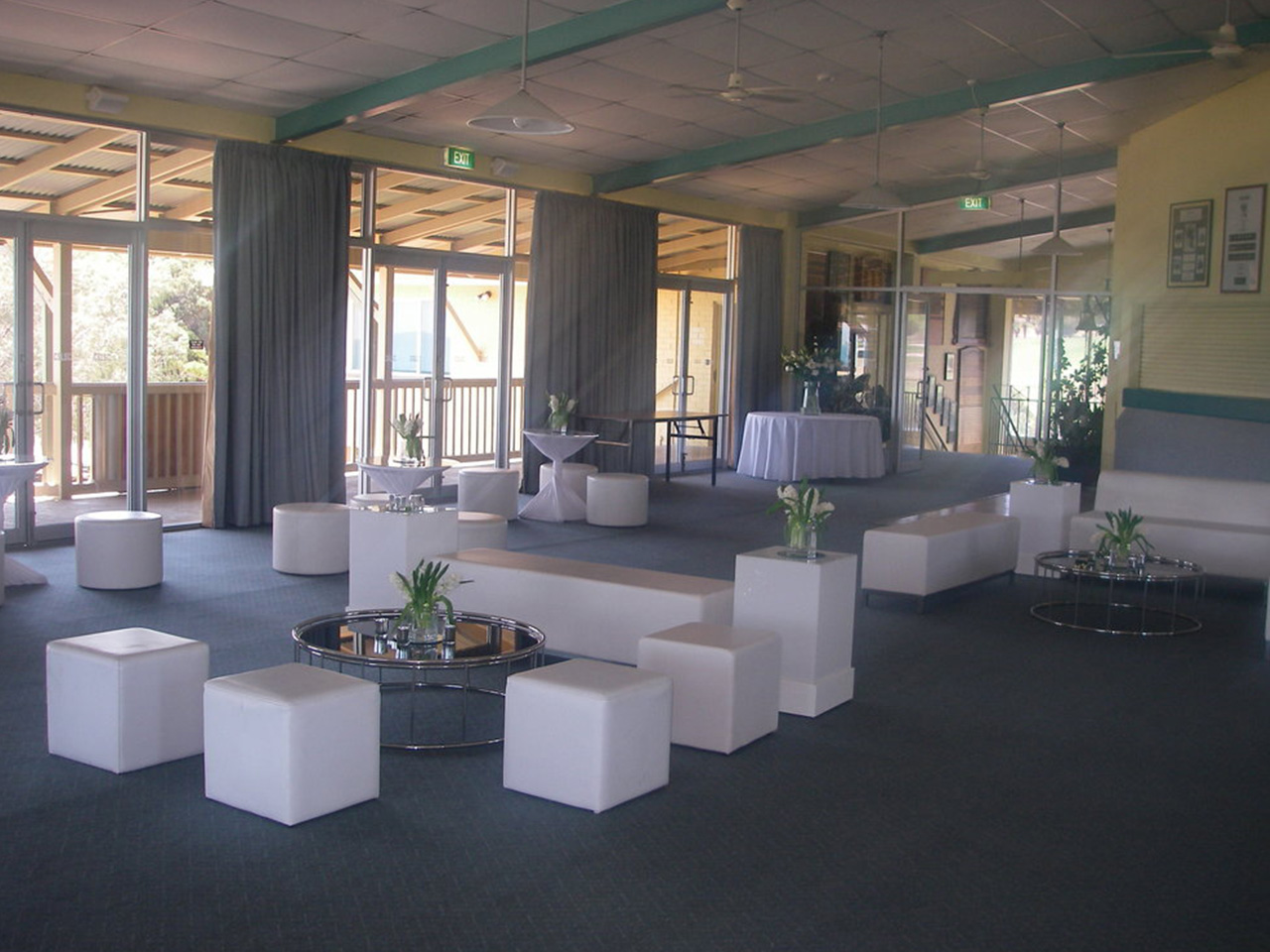 White Chairs With Tables Inside The Function Room