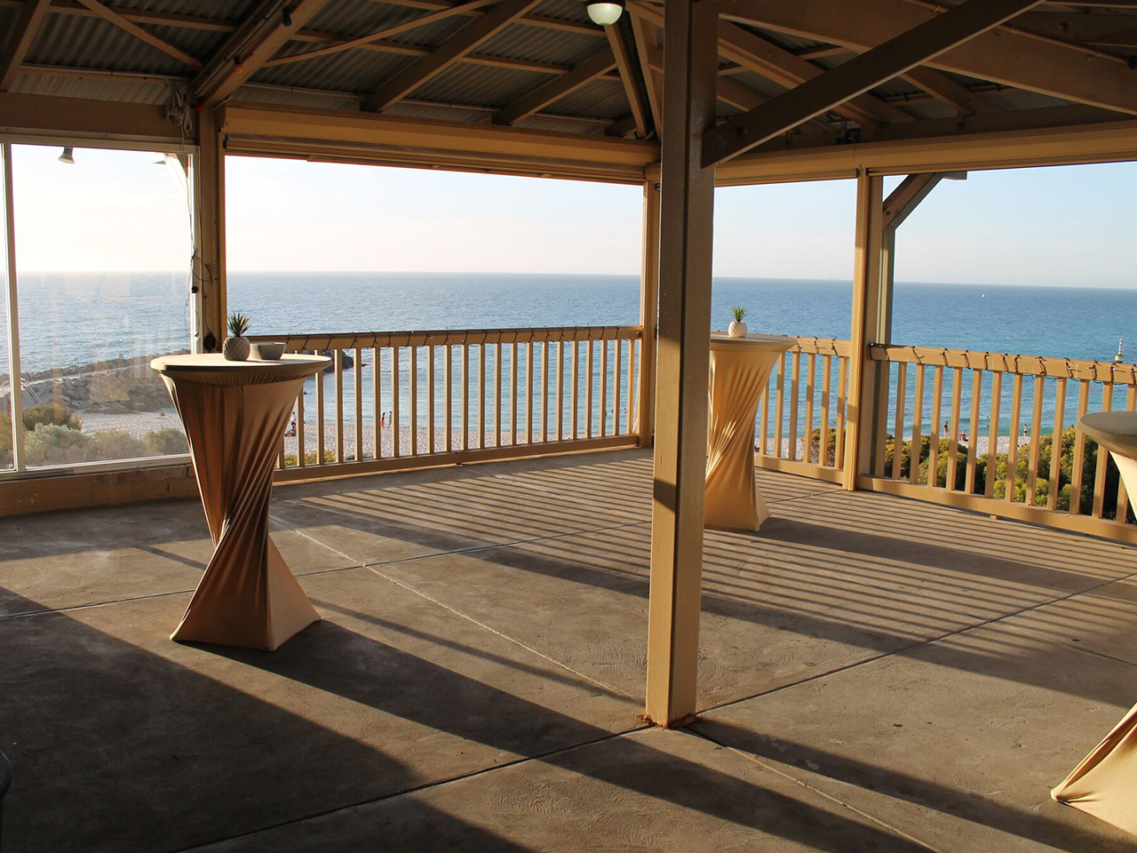 Balcony With Cocktail Tables And Ocean View