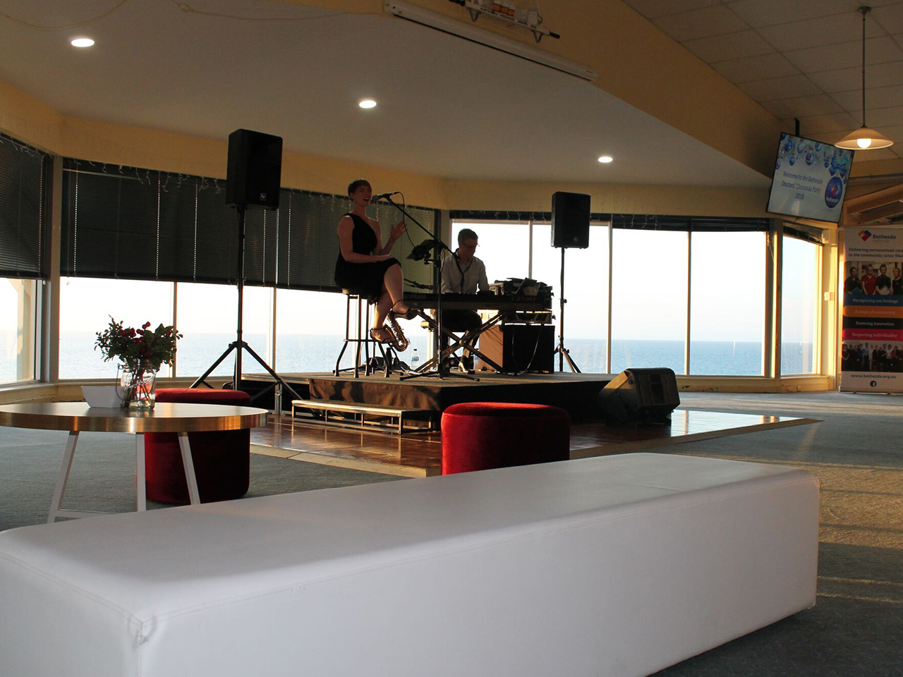 A Band Rehearsing On Stage Inside The Bare Function Room