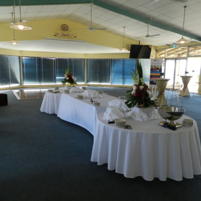 Cocktail Tables, White Round Tables And Flat Screen TV Inside The Function Room
