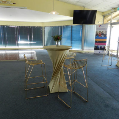 2 Cocktail Tables With High Chairs And Flat Screen TV Inside The Function Room