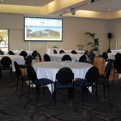 Banquet Style Setup With Projection Screen Inside The Function Room