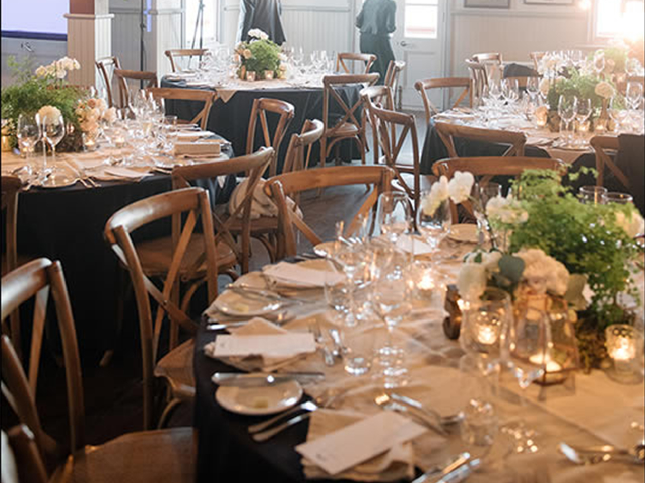 Chairs And Tables In Banquet Style With Centerpieces
