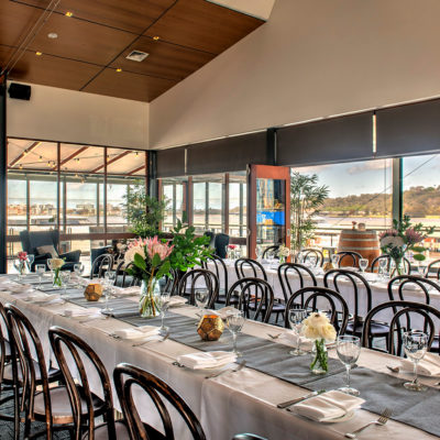 Chairs And Long Tables Setup For An Event Inside The Function Venue Perth With Full Length Glass Windows