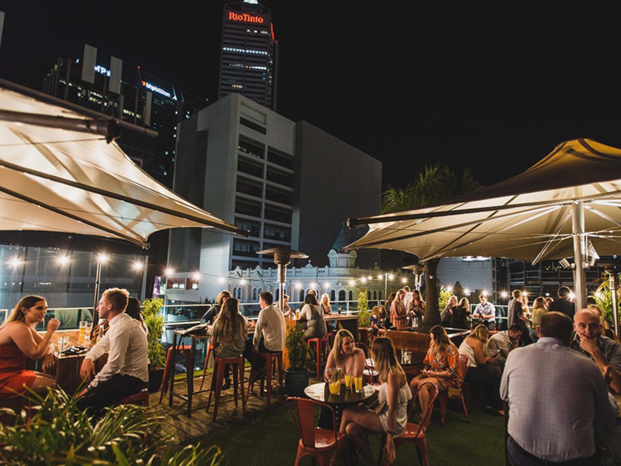 Guests Enjoying The Night In The Open Air Rooftop Perth Venues