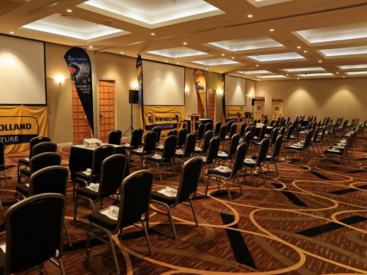 Chairs in Theatre Style Setup Inside The Swan Valley Function Room With 3 Projection Screens