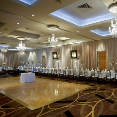 Swan Valley Venue With A Very Long Table On The Sides Of The Function Room With A Dance Floor And Chandeliers