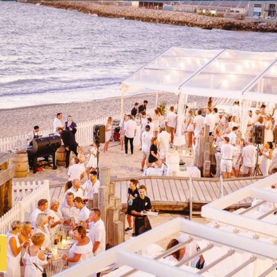 crowded event on beach front wedding venue
