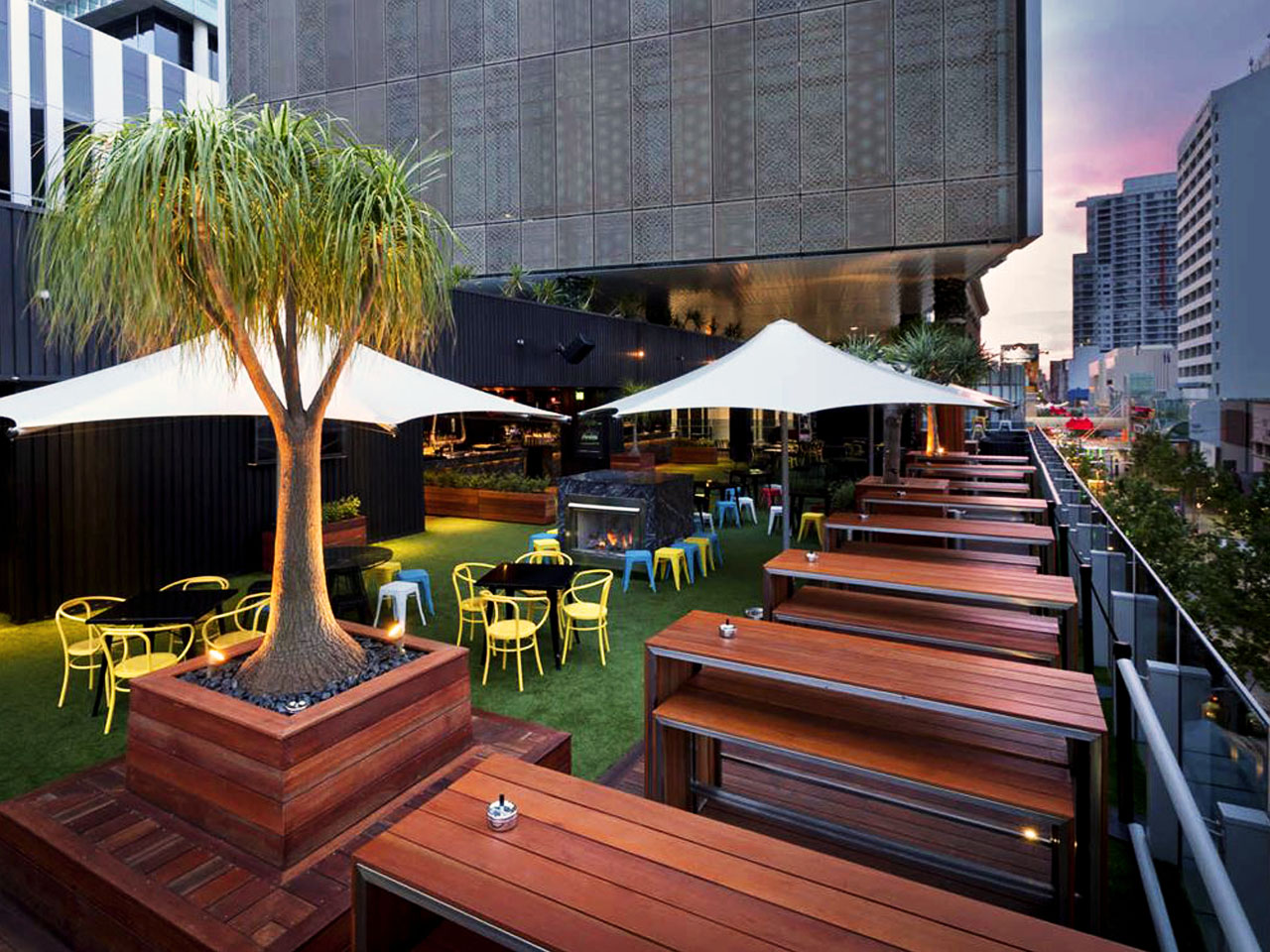 rooftop open air balcony with brown benches