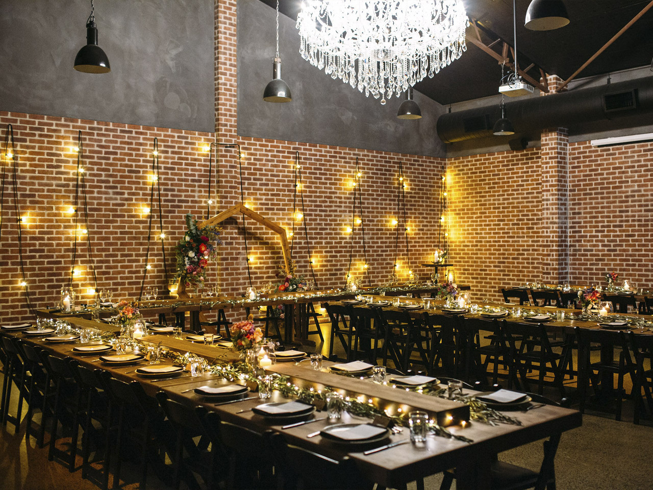 Full room setting with long tables and wall light decorations