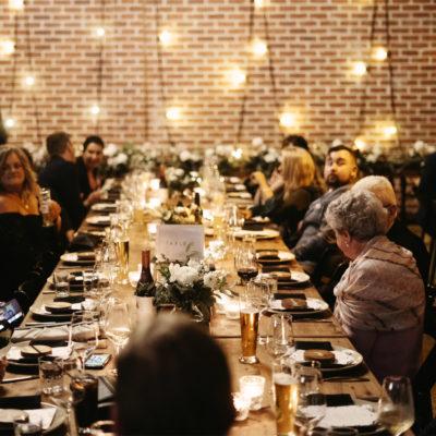 Guests at long tables enjoying a function
