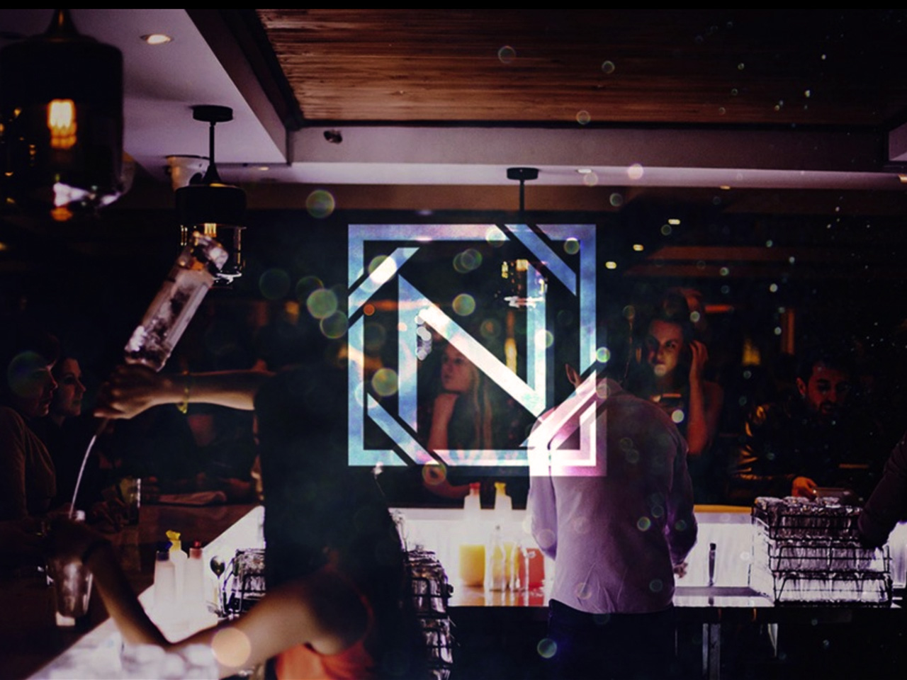 Niche logo with backdrop of people serving drinks