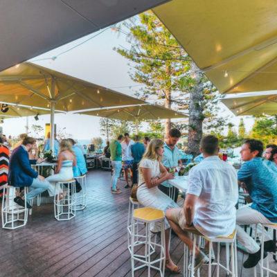People enjoying drinks on Alfresco outdoor dining area