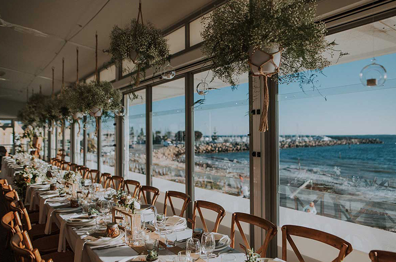 Long Table Next to the Floor to Ceiling Windows at Beach Venue in Perth