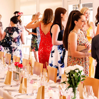 Guests Enjoying Inside The Function Room With A Long Table