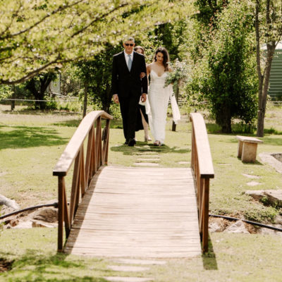 Father And Bride about to cross a small bridge outside