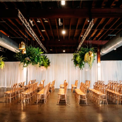Chairs Setup For A Conference With Hanging Indoor Plants Inside The Function Room