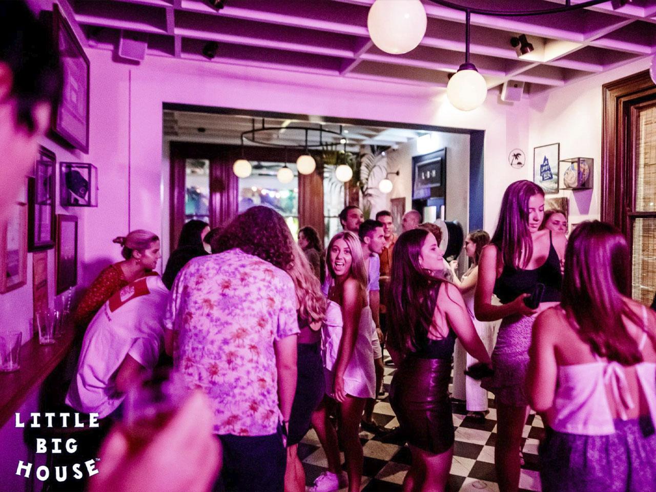 People on dance floor with purple haze lighting