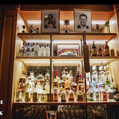 Drinks cabinet showing full selection of bottles spirits