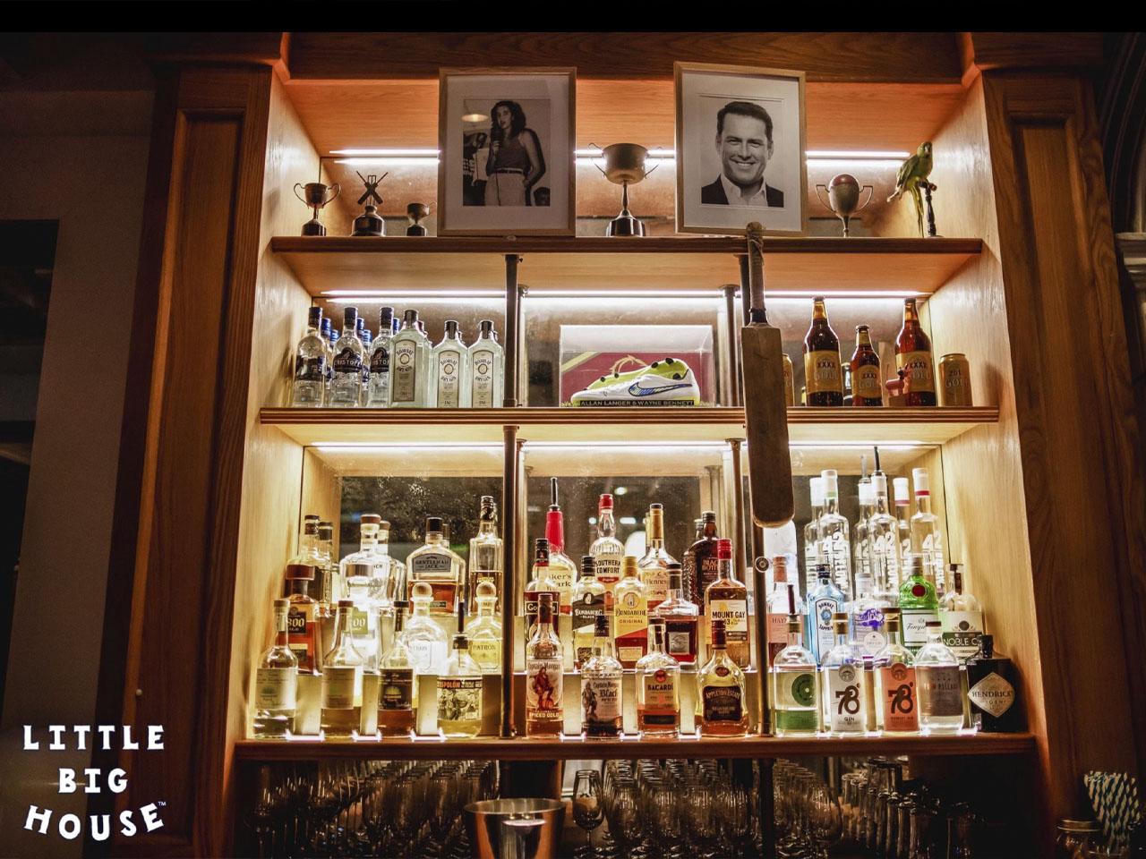 Drinks cabinet showing full selection of bottles spirits