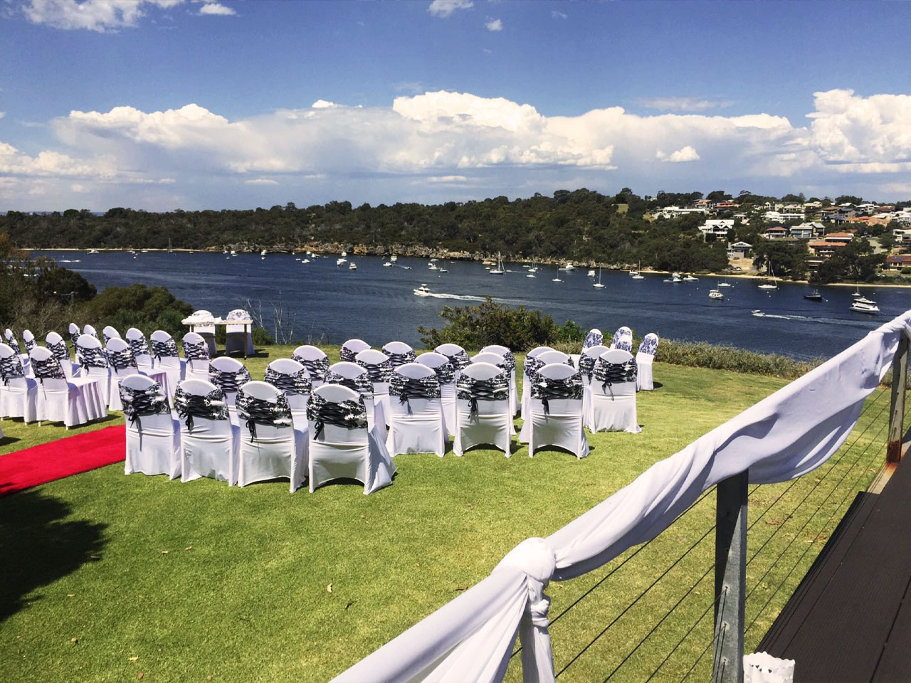Outdoor seating for wedding with white seats overlooking river