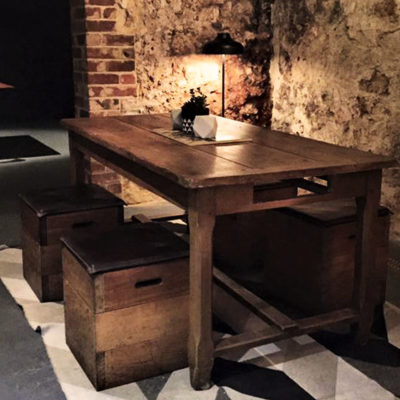 Wooden dining table in corner of room at night