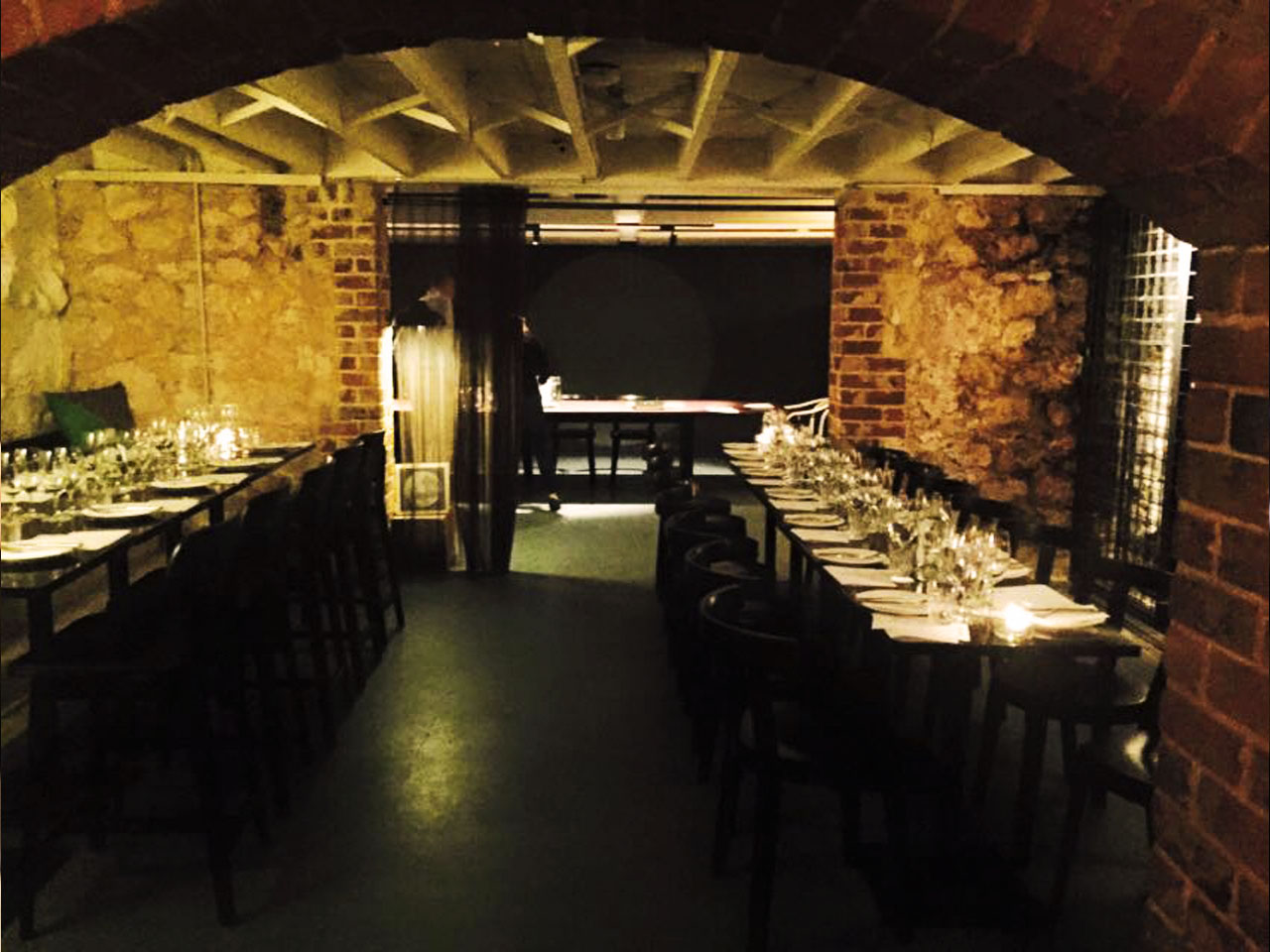 Inside The Small Venue With Brick Walls And Variety Of Chairs And Tables