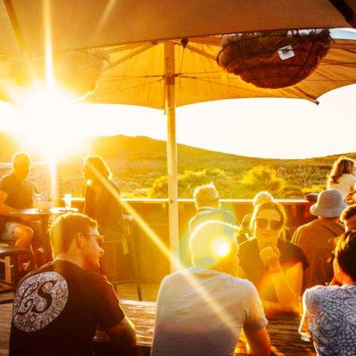 Few Guests Enjoying The Sun In The Function Venue's Alfresco