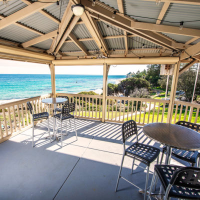 Function Room's Terrace With Ocean View, Few Chairs And Tables