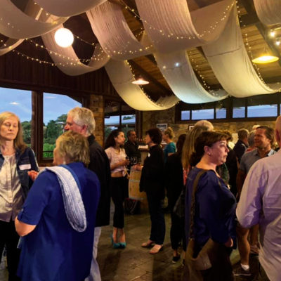 Guests Enjoying Their Drinks In An Event With Ceiling Draping Inside The Function Room