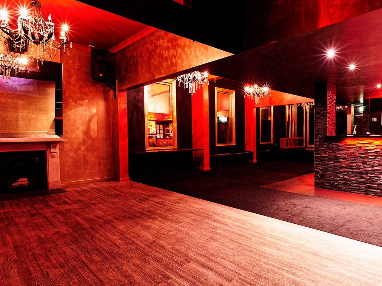 Empty Function Room With Chandelier And Red Lighting