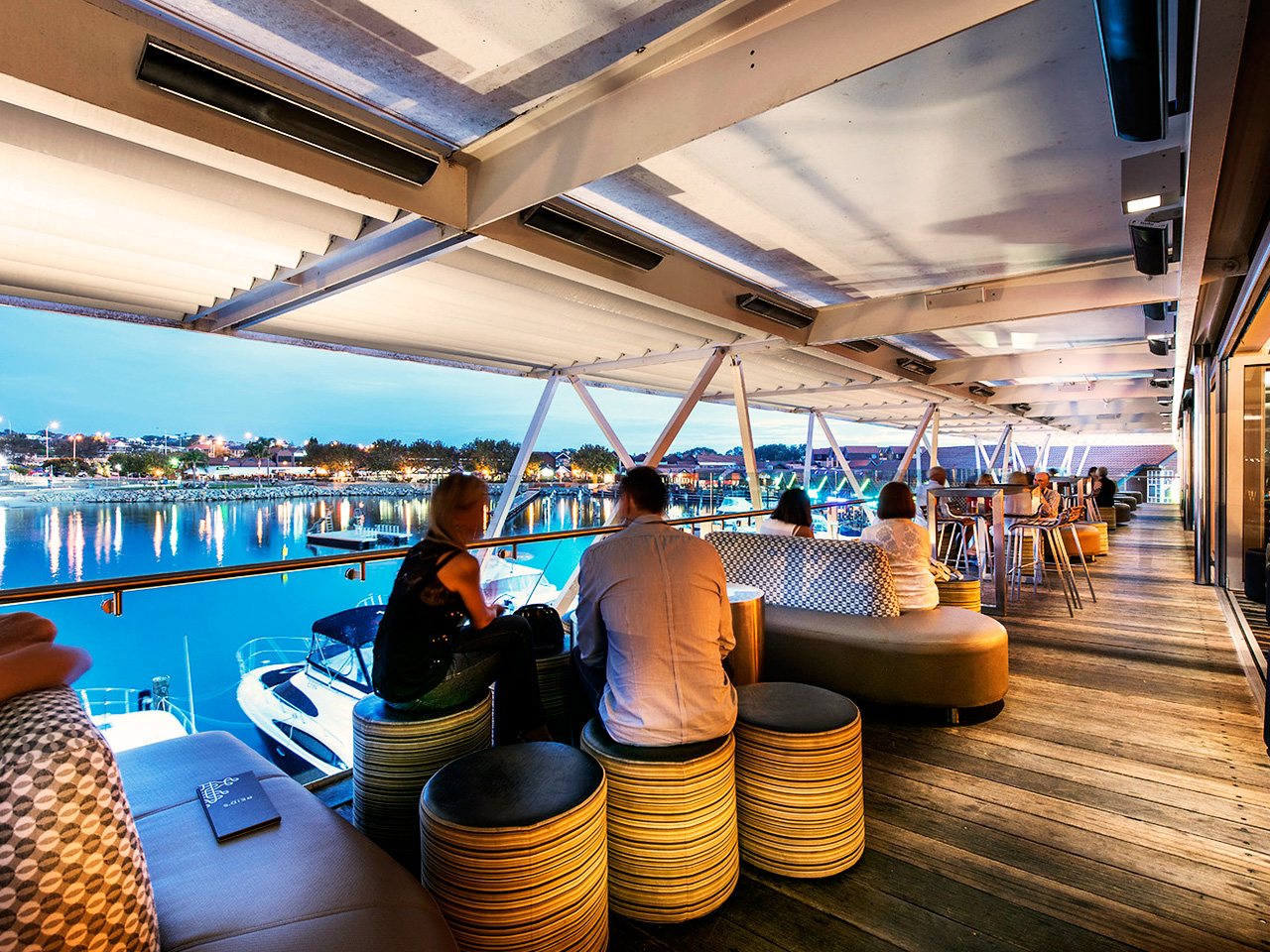 Guests Enjoying The Ocean View In Dusk In The Function Room's Terrace