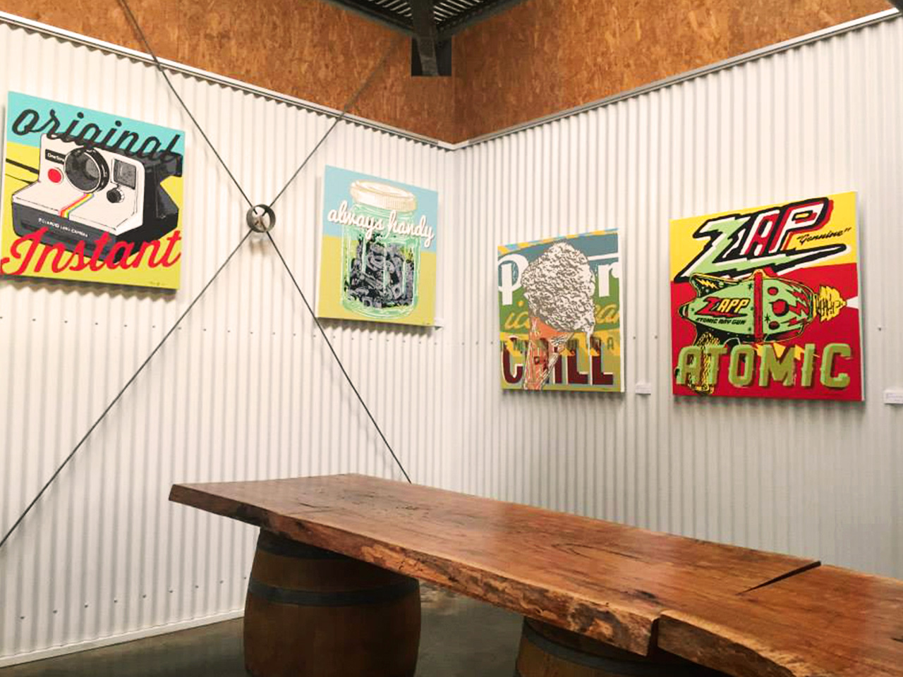 Wooden Table Inside The Function Room With Wall Arts