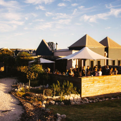Outside View Of The Function Venue With Few Guests In The Alfresco