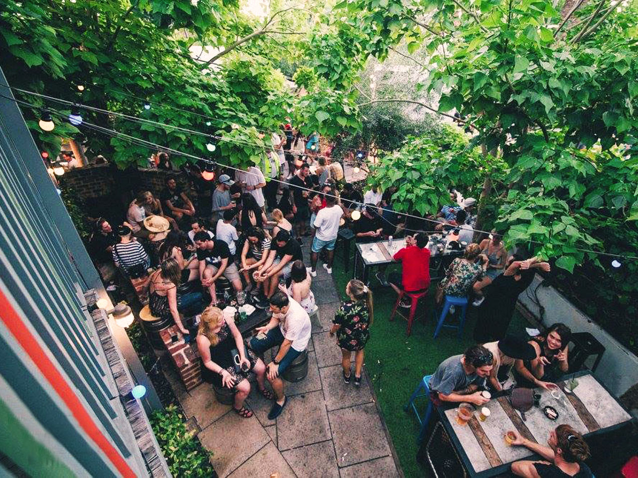 Balcony view of guests attending an event at The Backyard