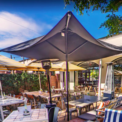 Tables And Chairs In The Garden Function Space With Umbrellas