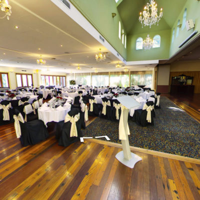 Chairs and tables In banquet style inside the function room with open doors to garden