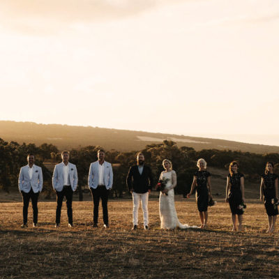 Bridal party at sunset on a hill
