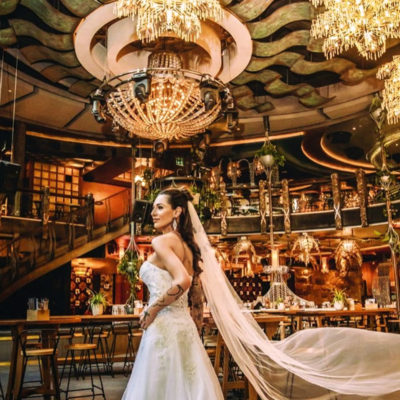 Bride walking through lavish dining area