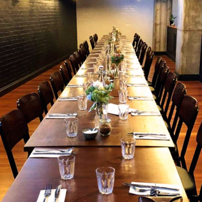 Empty dining space with long table