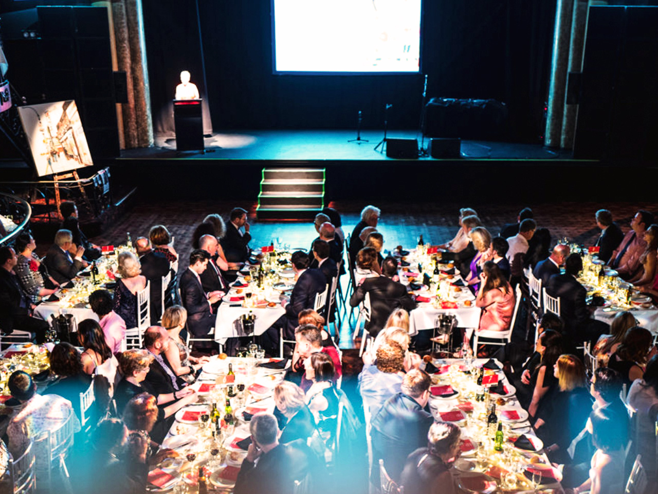 Presentation on stage with long table setting