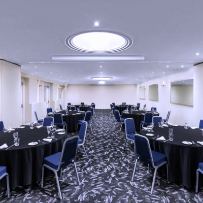 Conference room with round table arrangement and projector screen