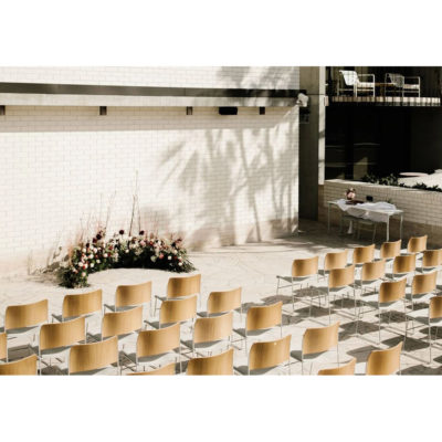 Roof top row seating facing ceremony flowers