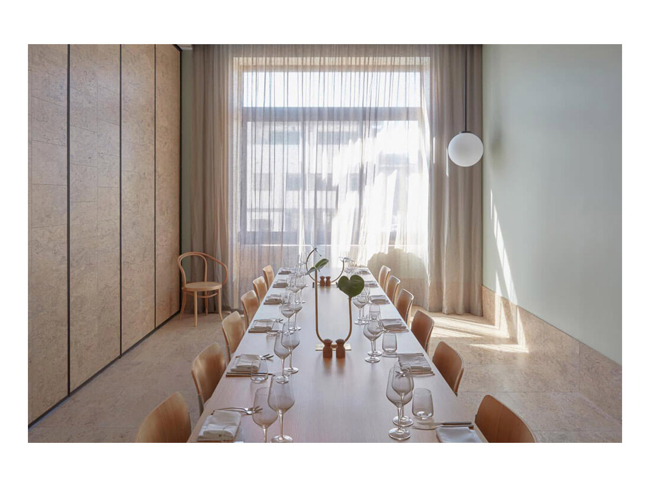 Meeting room featuring long table facing windows