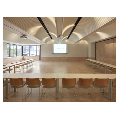 Function room with U-shaped layout facing a projector screen