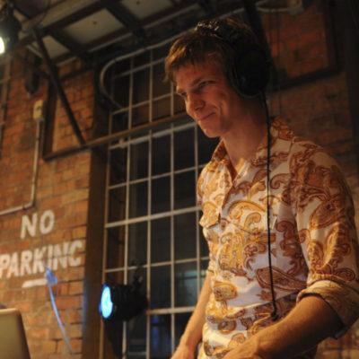 DJ with headphones enjoying his set