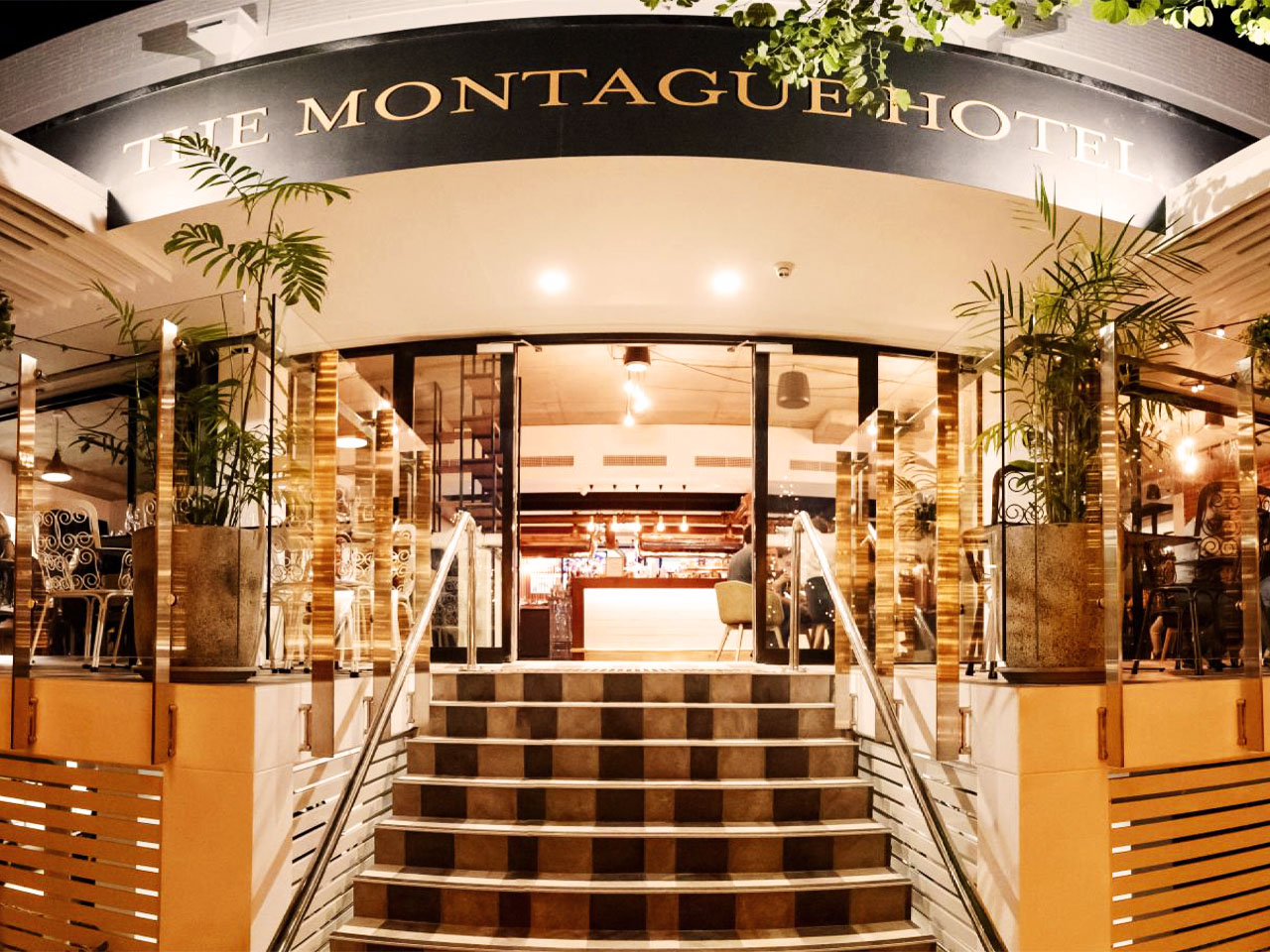 Montague Hotel entrance with sign above steps