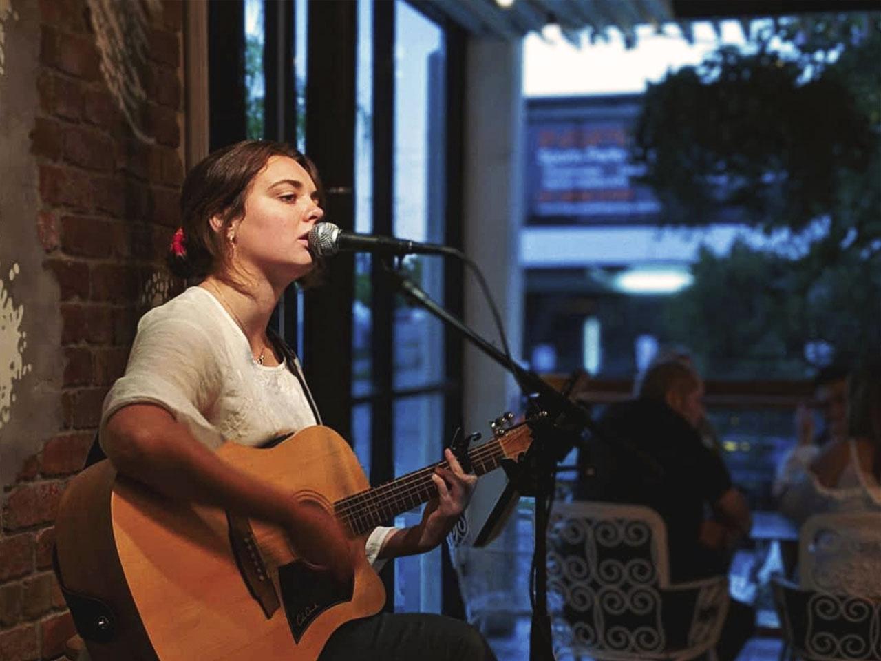 Lady singer playing guitar