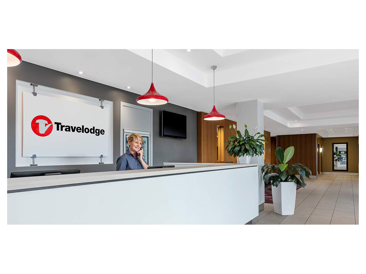 Travelodge reception area with lady on phone