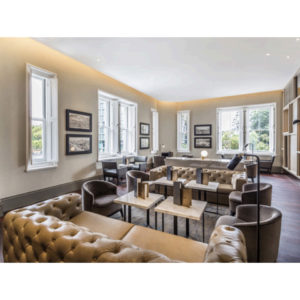 Luxurious event space with brown decor and couch and coffee tables